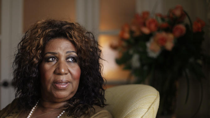 "In this July 26, 2010 photo, performer Aretha Franklin looks out a window, in Philadelphia. Franklin says she believed Whitney Houston had overcome her demons and was primed for a comeback, which made learning of the troubled singer's death all the more of a shock. Interviewed on NBC's ""Today"" show Friday, Feb. 17, 2012, Franklin said she was watching TV in her hotel room in Charlotte, N.C., when she learned of Houston's death. (AP Photo/Matt Rourke)"