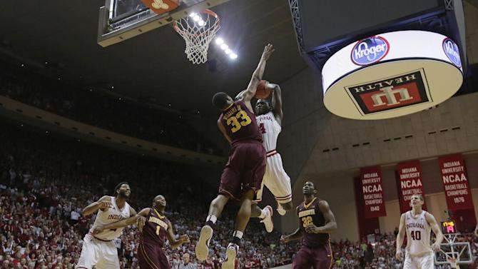 Indiana's Victor Oladipo (4) goes up for a dunk against Minnesota's Rodney Williams (33) during the second half of an NCAA college basketball game, Saturday, Jan. 12, 2013, in Bloomington, Ind. Indiana defeated Minnesota 88-81. (AP Photo/Darron Cummings)