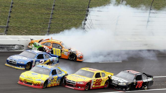 Kyle Busch (18) hits the wall while Brad Keselowski (2), Ryan Newman (39), Sam Hornish Jr. (22) and Kurt Busch (78) tangle trying to avoid the crash during a NASCAR Sprint Cup Series auto race at Kansas Speedway in Kansas City, Kan., Sunday, Oct. 21, 2012. (AP Photo/Colin E. Braley)
