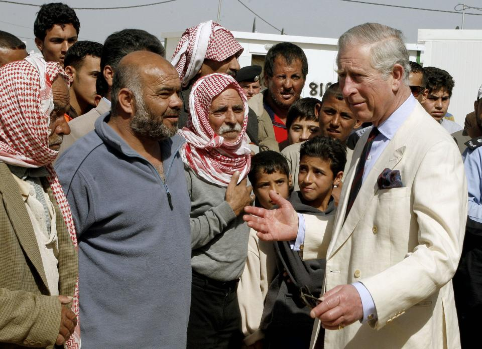 Britain's Prince Charles, right, speaks to Syrian refugees during his visit to the King Abdullah Park for Syrian Refugees in Ramtha city north of Amman, Jordan, Wednesday, March 13, 2013. Prince Charles and his wife Duchess Camilla are in Amman on a three-day official visit. (AP Photo/Jamal Nasrallah, Pool)