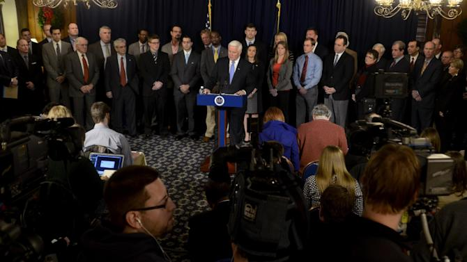 Gov. Tom Corbett announces plans to file a federal anti-trust lawsuit against the NCAA over sanctions imposed against Penn State in the wake of the Jerry Sandusky child sexual abuse scandal in State College, Pa. on Wednesday, January 02, 2013. Flanked by local business and political figures Corbett stated the suit contends the NCAA sanctions were over-reaching and unlawful. (AP Photo/Ralph Wilson)