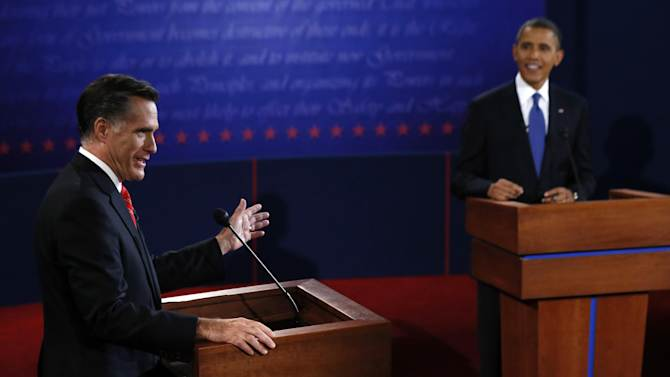 President Barack Obama listens as Republican presidential nominee Mitt Romney answers a question during the first presidential debate at the University of Denver, Wednesday, Oct. 3, 2012, in Denver. (AP Photo/Pool, Rick Wilking)