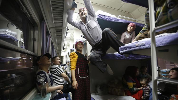 A Uighur group travel on the train to Xingjiang, in Shanghai