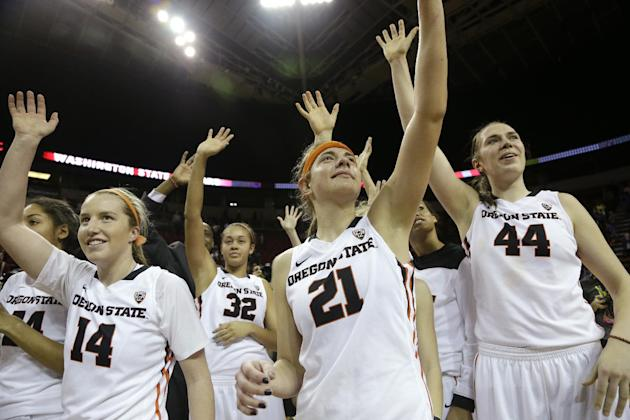 Oregon State's Ali Gibson (14), Deven Hunter (32), Sydney Wiese (21) and Ruth Hamblin (44) wave with teammates to fans after beating Washington State in an NCAA college basketball game in the Pac-