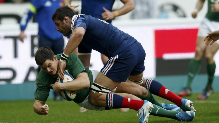 Ireland's Jonathan Sexton scores a try during the Six Nations rugby union match against France at the Stade de France in Saint-Denis, near Paris