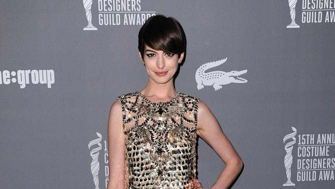 Anne Hathaway arrives at the 15th Annual Costume Designers Guild Awards at The Beverly Hilton Hotel on Tuesday, Feb. 19, 2013 in Beverly Hills. (Photo by Jordan Strauss/Invision/AP)
