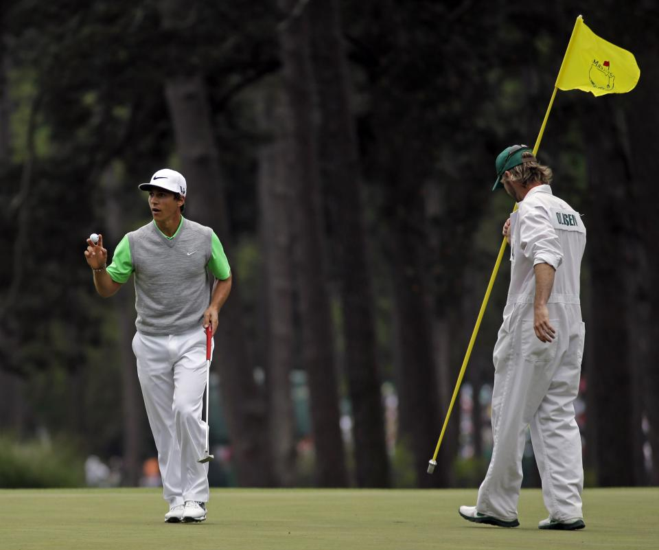 Thorbjørn Olesen, of Denmark, holds up his ball after a birdie on the third hole during the fourth round of the Masters golf tournament Sunday, April 14, 2013, in Augusta, Ga. (AP Photo/Matt Slocum)