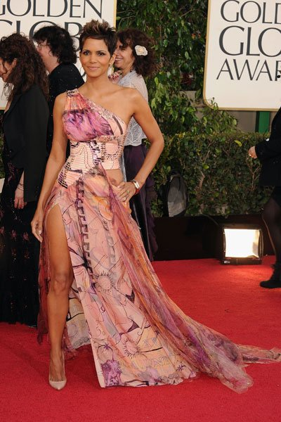 Halle Berry: Baby daddy drama aside, Halle Berry looks sexy in a colourful gown. And look, she's even pulling the Angelina Jolie leg! (Photo by Steve Granitz/WireImage)