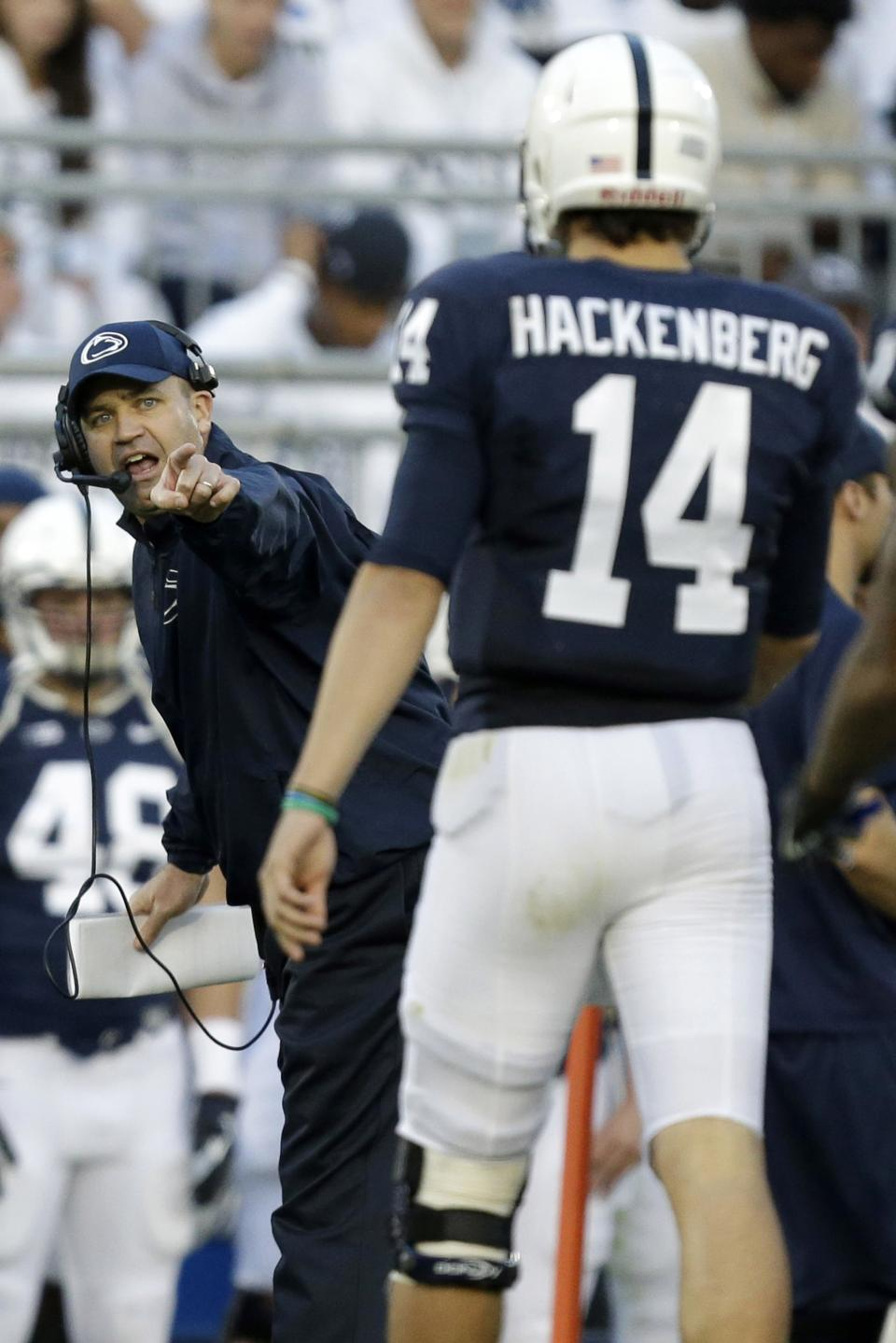 Penn State head coach Bill O' Brien, left, points to Penn State quarterback Christian Hackenberg (14) during a time out in the second quarter of an NCAA college football game against Michigan in State College, Pa., Saturday, Oct. 12, 2013. (AP Photo/Gene J. Puskar)