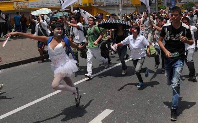 ** CORRECTS CITY AND BYLINE ** Students march during a protest in Medellin, Colombia, Wednesday, Oct. 12, 2011. The protest was against education reforms planned by the government that propose private funding for public institutions. (AP Photo/Luis Benavides)