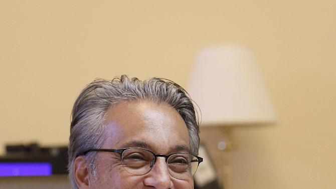 In this photo taken Friday, Oct. 26, 2012, Sheriff Ross Mirkarimi smiles during an interview in his office in San Francisco. After about two weeks back on the job, San Francisco's sheriff said he is humbled and ashamed of the domestic violence case that ended in his criminal conviction and nearly forced him out of office. But Sheriff Ross Mirkarimi said he would not accede to demands by the district attorney and the mayor that he recuse himself from domestic-violence-related programs in the county's jails. (AP Photo/Jeff Chiu)