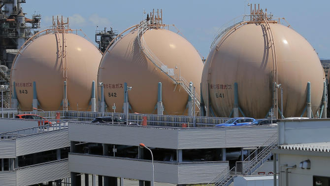 FILE - In this Aug. 22, 2012 file photo, liquefied petroleum gas storage tanks stand at an industrial area in Yokohama in Kanagawa prefecture, south of Tokyo. Japan's trade deficit in 2012 rose to a record 6.93 trillion yen ($78.3 billion), as fuel imports surged and a bitter territorial dispute with China hammered its exports. The provisional figures reported by the Finance Ministry on Thursday, Jan. 24, 2013 showed the trade deficit narrowed, however, in December, to 641.5 billion yen ($7.25 billion) from the 954.8 billion yen shortfall in November. (AP Photo/Itsuo Inouye, File)