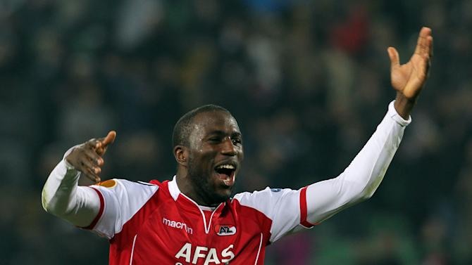 "FILE - In this Thursday, March 15, 2012 file photo AZ Alkmaar's Jozy Altidore, of the United States, celebrates at the end of the Europa League, round of 16, second leg soccer match against Udinese at the Udine Friuli stadium, Italy. Dutch club FC Den Bosch is vowing to do all it can to identify and punish a group of fans who hurled racist abuse at AZ Alkmaar and United States striker Jozy Altidore during a cup quarterfinal. Den Bosch said Wednesday Jan. 30, 2012, that fans responsible for the monkey chants in the KNVB Cup tie ""do not belong in the De Vliert (stadium) and will face the toughest possible sanctions."" (AP Photo/Paolo Giovannini, File)"