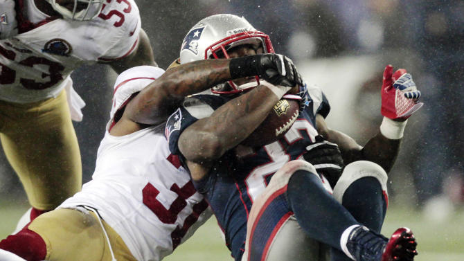 San Francisco 49ers strong safety Donte Whitner (31) tackles New England Patriots running back Stevan Ridley (22) in the second quarter of an NFL football game in Foxborough, Mass., Sunday, Dec. 16, 2012. (AP Photo/Steven Senne)