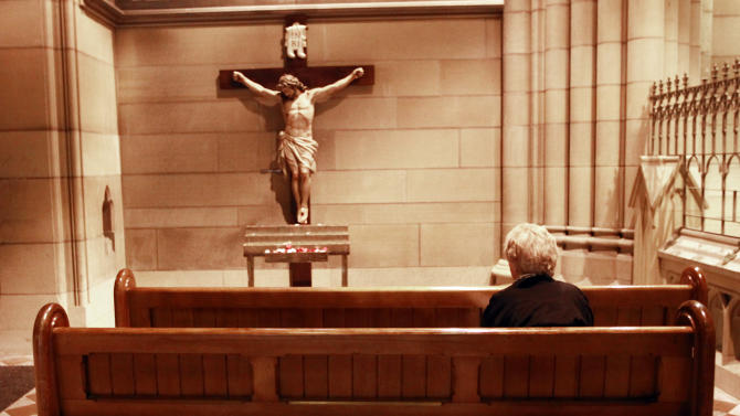 A Catholic devotee prays at the St Mary's Cathedral in central Sydney