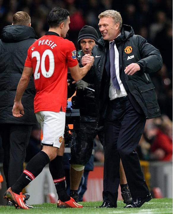 Manchester United manager David Moyes (R) and player Robin van Persie, seen at the final whistle of their English Premier League match against Arsenal, at Old Trafford in Manchester, northwest England