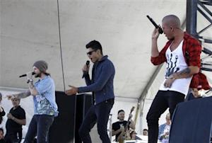 Members of The Wanted, an English-Irish boy band, perform in the Village during the iHeartRadio Music Festival in Las Vegas