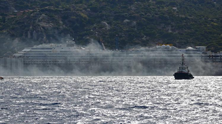 Black smoke comes out from the back of the Costa Concordia cruise liner during its refloat operation at Giglio harbour