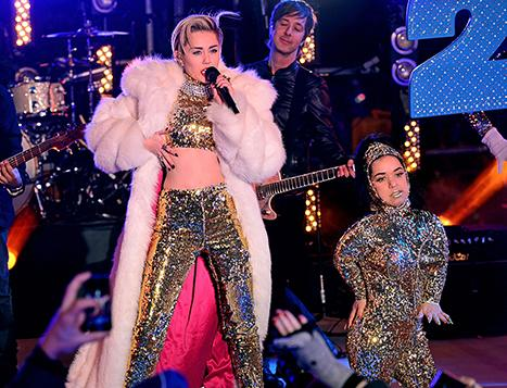 Miley Cyrus Wears Gold Ensemble, Has Three Women Hold White Fur Coat On NYE: Picture