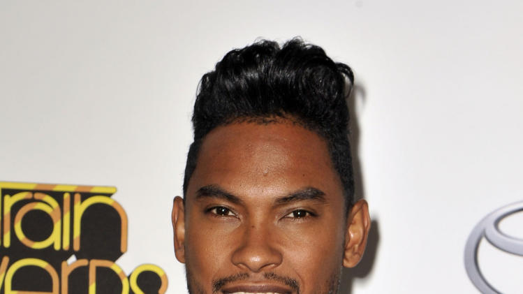 """FILE - In this Thursday, Nov. 8, 2012 file photo, Miguel arrives at the Soul Train Awards at Planet Hollywood Resort and Casino in Las Vegas. Miguel is up for five Grammy Awards, including song of the year for his crossover hit, """"Adorn.""""  (Photo by Jeff Bottari/Invision/AP, File)"""