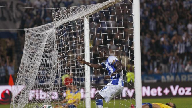 Porto's Jackson Martinez stands in the net after scoring a second goal against Arouca during their Portuguese premier league soccer match in Arouca
