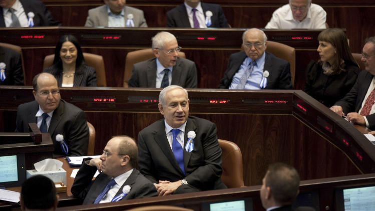 Israeli Prime Minister Benjamin Netanyahu, center, attends a session at the Knesset during the opening session of Israel's newly elected parliament in Jerusalem, Tuesday, Feb. 5, 2013. Israel's president praised President Barack Obama's approach to countering Iran's suspect nuclear program on Tuesday, while sending a veiled message to Israel's incoming government not to act alone to stop it. (AP Photo/Uriel Sinai, Pool)