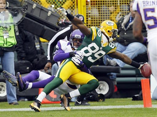 2 Burnett INTs key Green Bay's 23-14 win