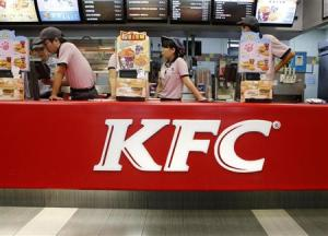 File photo of KFC's staff wait for customers at its restaurant in Beijing