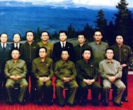 <p>A handout picture from 1991 shows North Korean leader Kim Jong-Il (First row, L), accompanied by his party leaders, with Japanese sushi chef Kenji Fujimoto (Second row, right) at a state banquet hall in Pyongyang.</p>