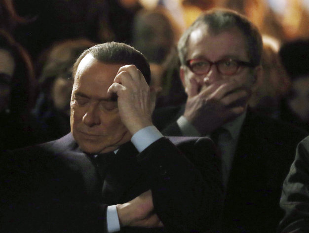Former Italian Premier Silvio Berlusconi, foreground, sits in front of Norther League party&#39;s leader Roberto Maroni in Milan, Italy, Sunday, Jan. 27, 2013. Silvio Berlusconi says Benito Mussolini did much good, except for dictator&#39;s regime&#39;s anti-Jewish laws. Berlusconi also defended Mussolini for siding with Hitler, saying the late fascist leader likely reasoned that German power would expand so it would be better for Italy to ally itself with Germany. He was speaking to reporters Sunday on the sidelines of a ceremony in Milan to commemorate the Holocaust. When Germany&#39;s Nazi regime occupied Italy during World War II, thousands from the tiny Italian Jewish community were deported to death camps. In 1938, before the war&#39;s outbreak, Mussolini&#39;s regime passed anti-Jewish laws, barring them from universities and many professions, among other bans. Berlusconi called the laws Mussolini&#39;s &quot;worst fault&quot; but insisted that in many other things, &quot;he did good.&quot; (AP Photo/Antonio Calanni)