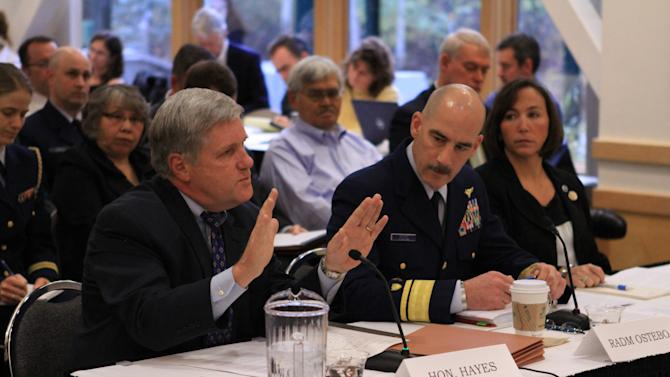 Interior Deputy Secretary David Hayes testifies on 2012 Arctic offshore drilling before the U.S. Senate Oceans, Atmosphere, Fisheries and Coast Guard Subcommittee on Thursday, Oct. 11, 2012, in  Anchorage, Alaska, as Coast Guard Read Adm. Thomas Ostebo and Acting National Weather Service Director Laura Furgione listen. (AP Photo/Dan Joling)