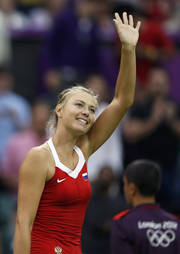 Russia's Sharapova waves to the spectators after winning against Israel's Peer in their women's singles tennis match at the All England Lawn Tennis Club during the London 2012 Olympics Games
