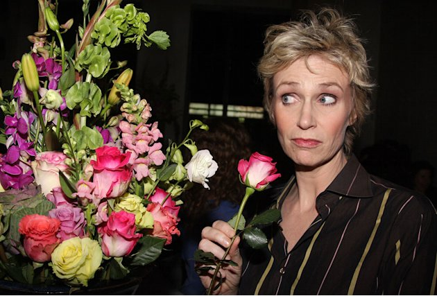 "Jane Lynch poses at a party celebrating the new cast of ""Love, Loss, and What I Wore"" at 44 1/2 on October 21, 2009 in New York City."