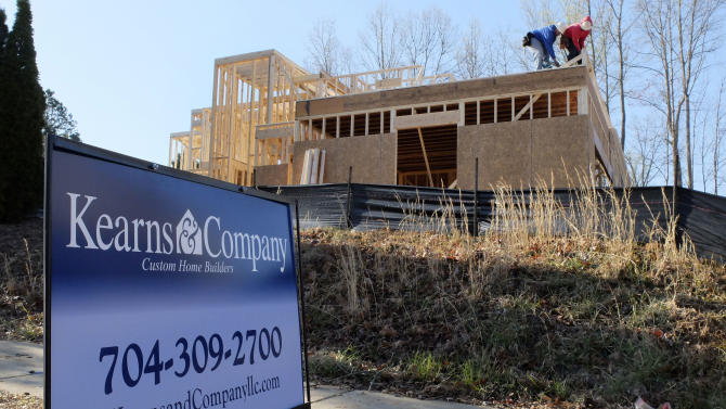In this Friday, March 29, 2013, photo, a worker helps frame a new home under construction in Matthews, N.C. The Commerce Department reports on new-home sales for March on Tuesday, April 23, 2013. (AP Photo/Chuck Burton