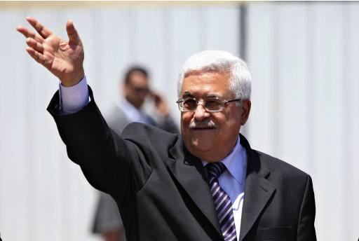 Palestinian President Mahmoud Abbas gestures during a welcoming ceremony for the Dominican Republic President Leonel Fernandez, not seen, in the West Bank city of Ramallah, Sunday, June 19 2011. (AP Photo/Majdi Mohammed)