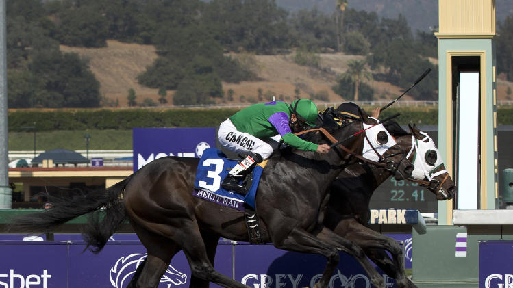 Hightail, rear right, ridden by Rajiv Maragh noses ahead of Merit Man (3), ridden by Patrick Valenzuela, at the wire to win the Juvenile Sprint horse race at the Breeders' Cup, Friday, Nov. 2, 2012, in Arcadia, Calif. (AP Photo/Julie Jacobson)