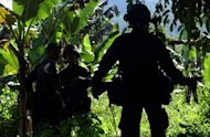 Philippine soldiers patrol the southern island of Jolo in 2007. The Philippines say they have killed three of Southeast Asia's most-wanted Islamic militants -- including a Malaysian bomb maker with a $5-million US government bounty on his head