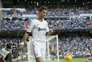 Real Madrid's Portuguese forward Cristiano Ronaldo reacts after scoring his first goal during the Spanish League football match Real Madrid vs Granada on September 2 at the Santiago Bernabeu stadium in Madrid. Madrid duo Ronaldo and Pepe joined up with their Portuguese national team colleagues on Monday, but neither is expected to train until Wednesday due to minor injuries