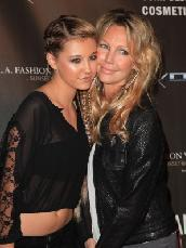 Ava Sambora and her mother Heather Locklear arrive at the WTB Spring 2011 Fashion Show at Sunset Gower Studios in Los Angeles on October 17, 2010 -- Getty Images