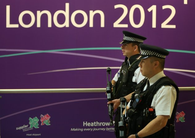 LONDON, ENGLAND - JULY 16: Armed poilice patrol Terminal 4 as Olympic athletes arrive at Heathrow Airport on July 16, 2012 in London, England. Athletes, coaches and Olympic officials are beginning to