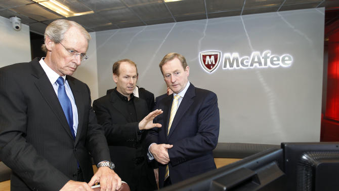 IMAGE DISTRIBUTED FOR IDA IRELAND - McAfee Inc. co-president's Todd Gebhart, left, Michael DeCesare, center, and Irish Prime Minister An Taoiseach Enda Kenny, check on the computer in the War Room at McAfee headquarters in Santa Clara, Calif., Thursday, March 21, 2013. Irish Prime Minister An Taoiseach Enda Kenny, today met with McAfee, the world's largest dedicated security company, to announce the company's establishment of a worldwide Centre of Excellence for Enterprise Security Solutions in Cork with the creation of up to 60 new high quality jobs (Tony Avelar/AP Images for IDA Ireland)