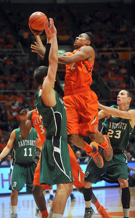 Illinois guard Joseph Bertrand (2) puts up a shot over Dartmouth forward/center Gabas Maldunas (12)in the first half in an NCAA college basketball Tuesday, Dec. 10, 2013, in Champaign, Ill