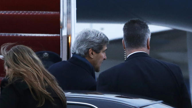 U.S. Secretary of State John Kerry boards his plane at Andrews Air Force Base, Md., en route to London in his inaugural official trip as Secretary on Sunday, Feb. 24, 2013. (AP Photo/Pool, Jacquelyn Martin)