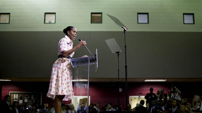 """FILE - In this Sept. 8, 2014 file photo, first lady Michelle Obama speaks at a voter registration rally in Atlanta. Washington is at the heart of a fierce partisan battle to shape Georgia's November midterm electorate, as Democrats try to recruit more minority voters to the polls in this increasingly diverse state. Republicans, meanwhile, are seeking just enough """"persuadable"""" voters to maintain the GOP's electoral advantage amid Georgia's tense, shifting political landscape.(AP Photo/David Goldman, File)"""