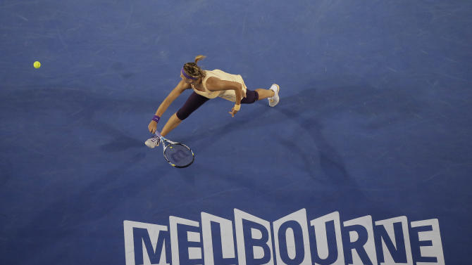Victoria Azarenka of Belarus reaches for a backhand return to China's Li Na during the women's final at the Australian Open tennis championship in Melbourne, Australia, Saturday, Jan. 26, 2013. (AP Photo/Rob Griffith)