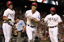 Texas Rangers David Murphy, center, and teammates Leonys Martin, left, and Elvis Andrus, right, are all smiles after Murphy hit a three-run home run during the sixth inning of a baseball game Sunday, May 19, 2013, in Arlington. (AP Photo/John F. Rhodes)