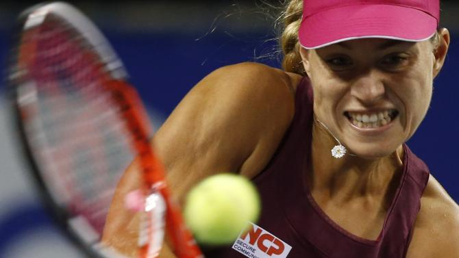 Kerber of Germany returns a shot to Ivanovic of Serbia during their Pan Pacific Open women's singles semi-final tennis match in Tokyo