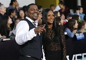 """Cast member Phifer and his wife Reshelet pose at the premiere of """"Divergent"""" in Los Angeles"""