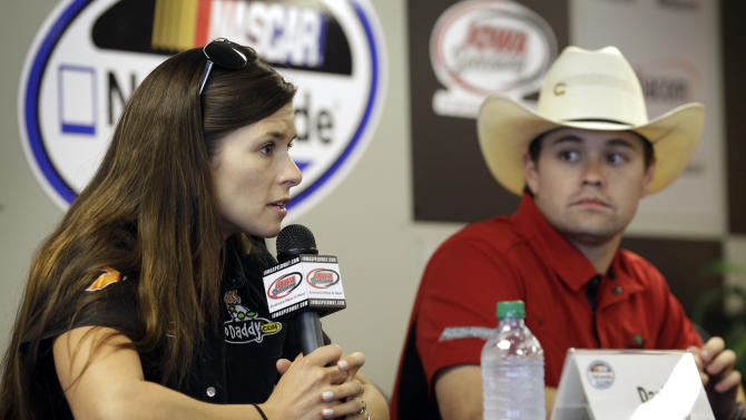 FILE - In this May 19, 2012 file photo, Danica Patrick speaks during a news conference as Ricky Stenhouse Jr., right, looks on before qualifying for the NASCAR Nationwide Series' Pioneer Hi-Bred 250 auto race at Iowa Speedway in Newton, Iowa. Patrick slid into her chair at NASCAR media day Thursday, Feb. 14, 2013 and promptly informed her audience she'd only answer racing-related questions.  Then she proceeded to talk candidly about her relationship with fellow driver Ricky Stenhouse Jr. (AP Photo/Charlie Neibergall, File)