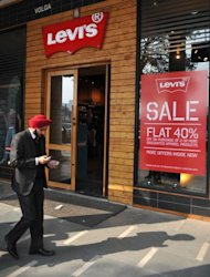 An Indian man walks past a Levi's store in New Delhi on January 11, 2012
